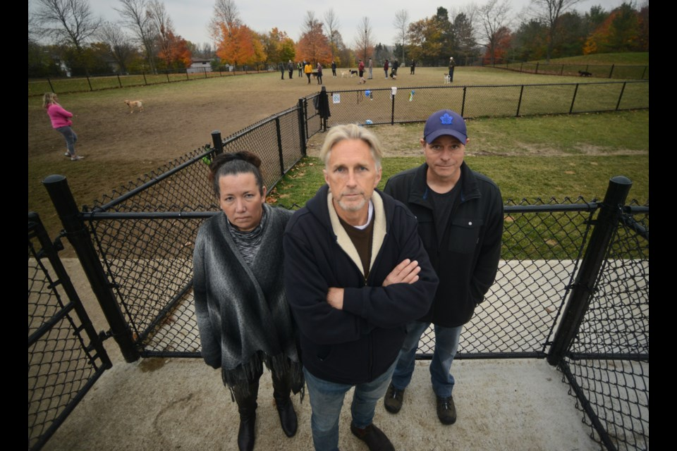 Sherry Cox, from left, John Farley and Darrell Allerton are all upset with the new fenced-in dog park in Misersky Park. Tony Saxon/GuelphToday