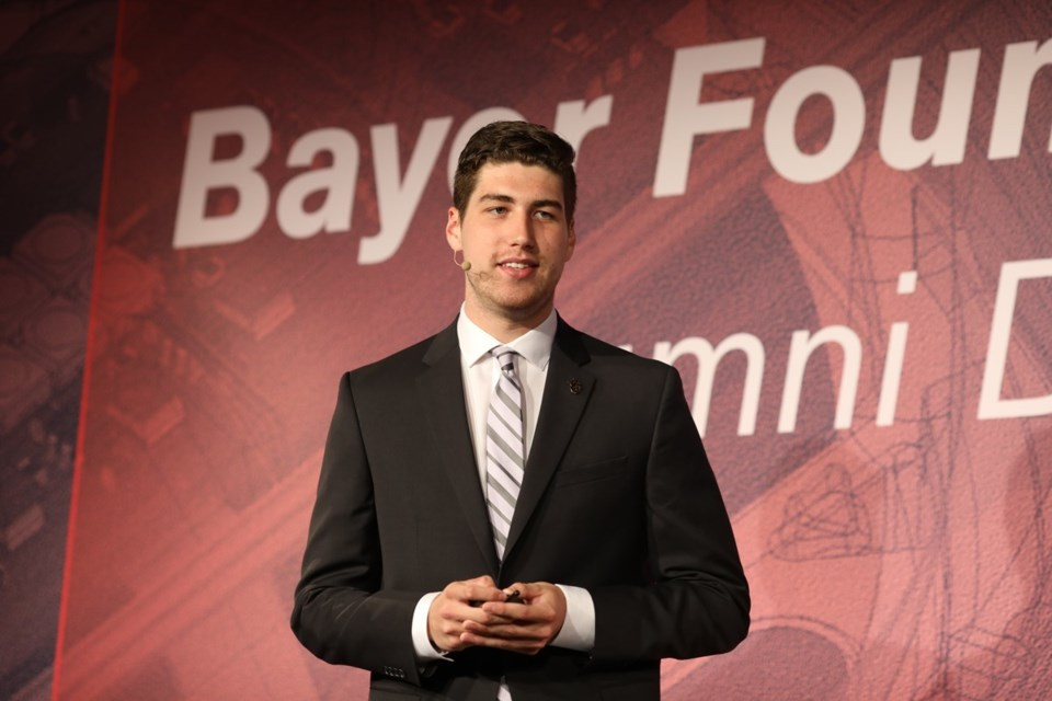 Connor Kiselchuk speaking at Bayer forum in Germany. Photo courtesy Connor Kiselchuk