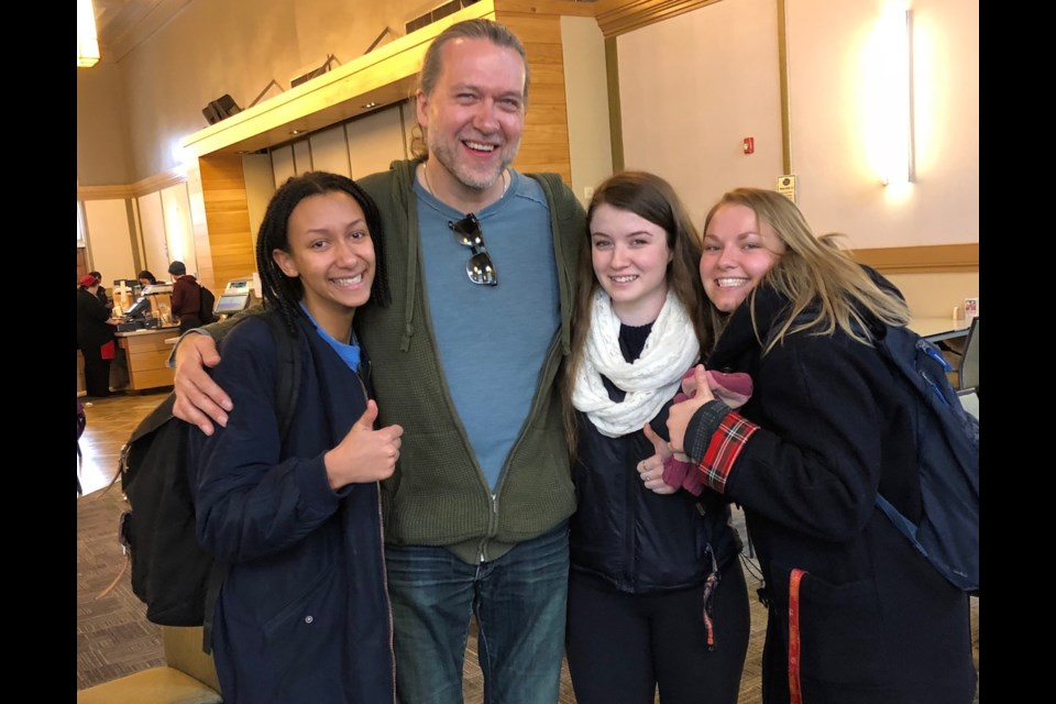 Chef Michael Smith's lunchtime visit to Creelman Hall gets a thumbs up from University of Guelph students Mya, Ali and Alicia. Photo by Owen Roberts