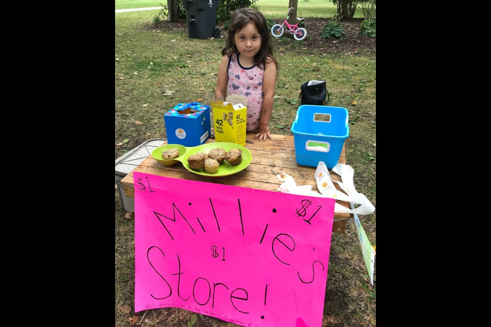 Millie Sinclair-Kruth and her Sunday store are open for business in Exhibition Park. Barbara Geernaert for GuelphToday.com
