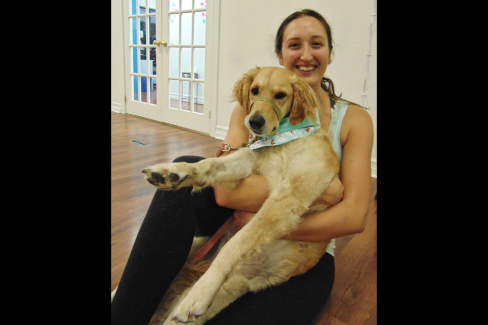 Instructor Kirstie Griffiths and her dog Downy at Loyobo Fit. Barbara Geernaert for GuelphToday