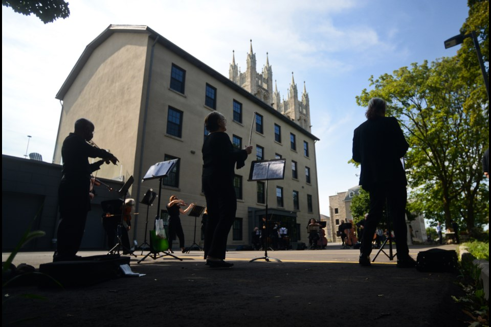 Members of the Guelph Symphony Orchestra perform a free walk-by concert in front of the Rectory on Catholic Hill in Downtown Guelph on Sunday. The night before they performed at the Mustang Drive-In prior to the movies that night. Tony Saxon/GuelphToday