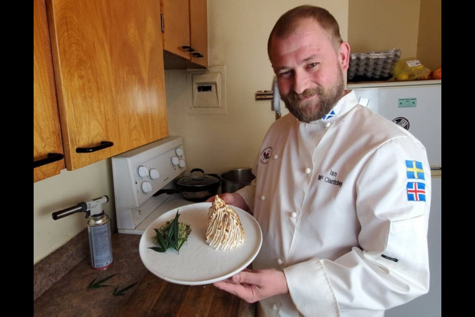 Chef Ian McClatchey shows off his signature dish, lemon haze baked Alaska. Supplied photo.