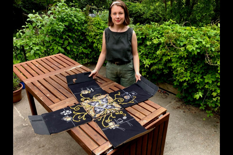Grade 12 student Maeve Brennagh shows off her artistic creation known as This Square is a Circle, which recently won a provincial Student Achievement Award. Barbara Geernaert photo