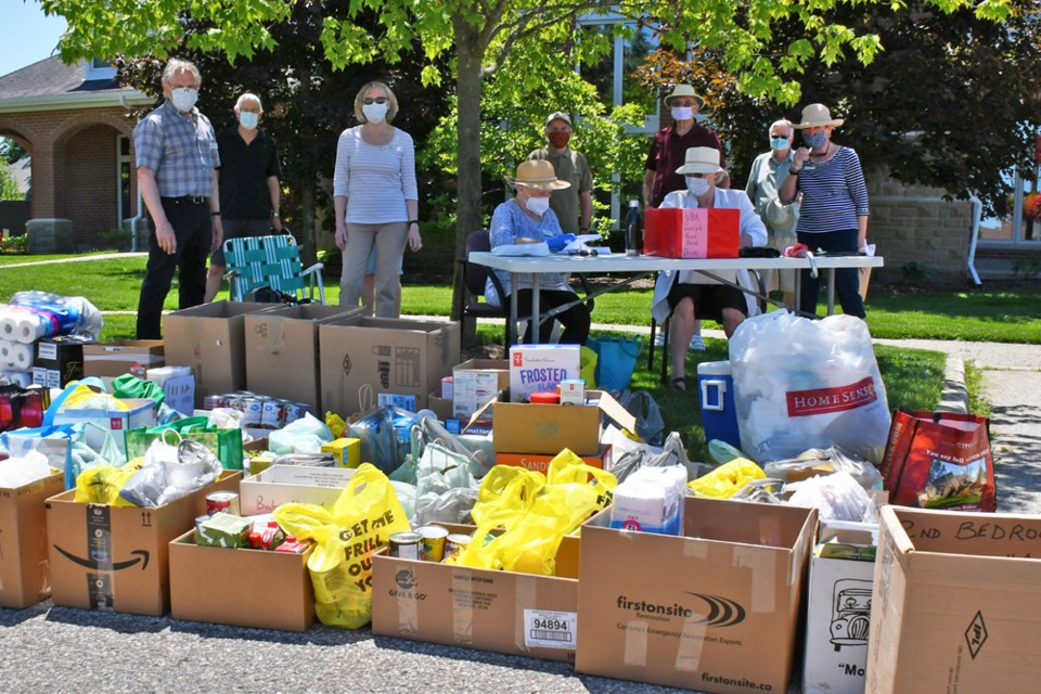 Residents of Village by the Arboretum gather donations for the Guelph Food Bank June 16. Supplied photo