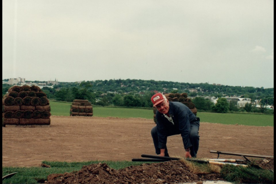 Robert Sheard laying some sod. Supplied photo