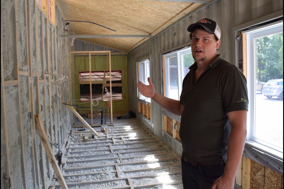 Container home builder Josh Smith explains the thickness of the installation in his 320 square foot dwelling.