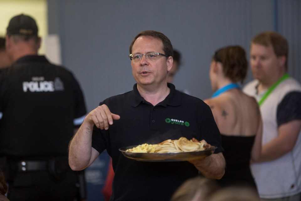 Mike Schreiner, leader of the Green Party of Ontario and local candidate for Guelph in the 2018 provincial election, helps volunteers serve breakfast at an event Wednesday at Lakeside Hope House. Kenneth Armstrong/GuelphToday
