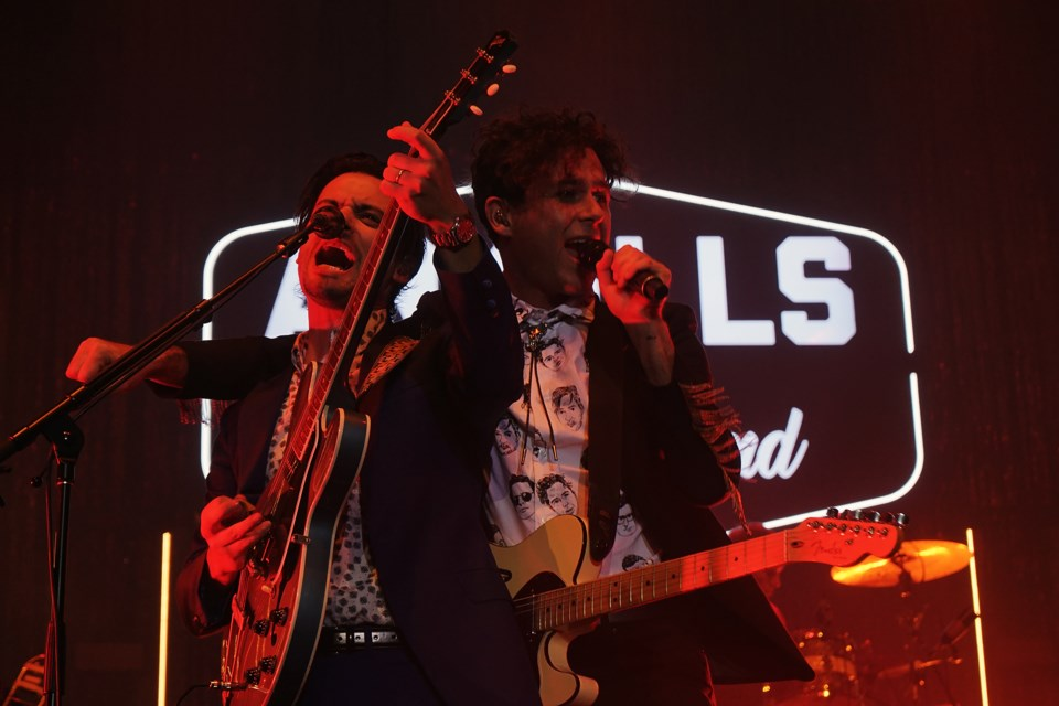 Arkells guitarist and Guelph native Mike DeAngelis (left) sings along with frontman Max Kerman during the band's performance Friday night at the Sleeman Centre. Kenneth Armstrong/GuelphToday