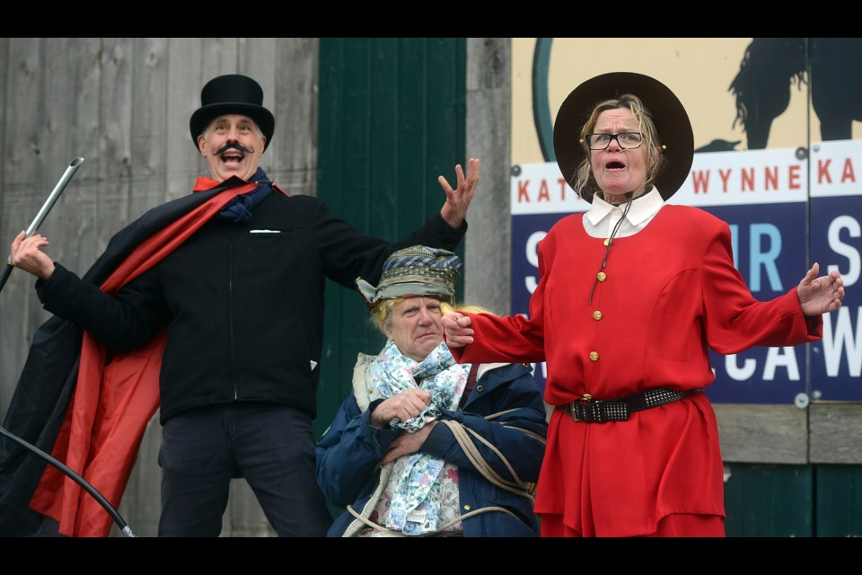 The 'Royal Society for the Prevention of Cruelty to Aquifers' perform 'Wynne or Lose,' a five-minute skit depicting the moral choice Kathleen Wynne faces in protecting local groundwater. The characters are Snidely Bigwater, from left, Little Miss Middlebrook and Premier Kathleen Wynne. Tony Saxon/GuelphToday