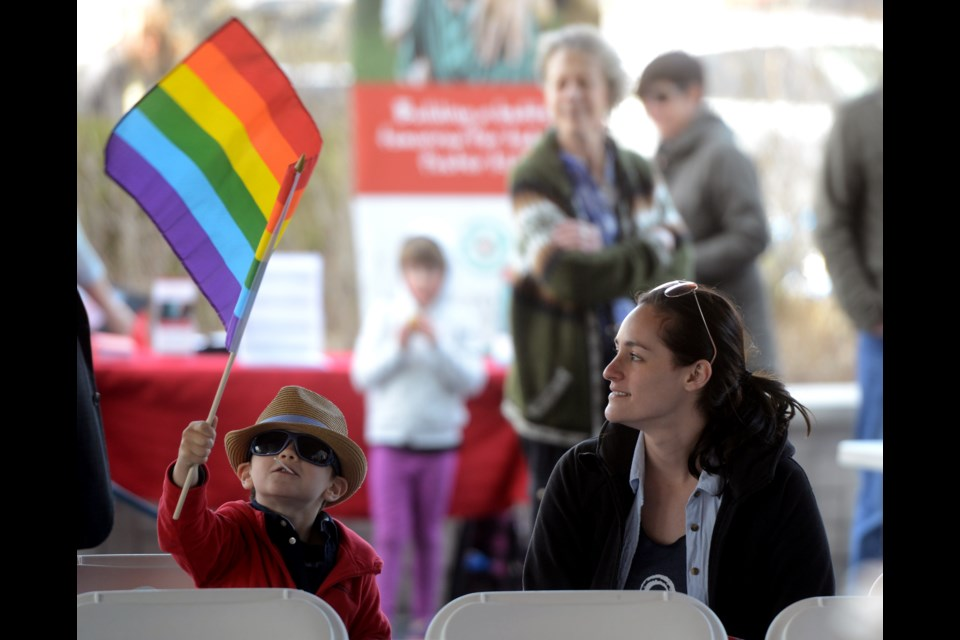 A young boy waves the rainbow flag during Guelph Pride week's flag raising ceremony Saturday, April 30, 2016, at Guelph City Hall. Tony Saxon/GuelphToday