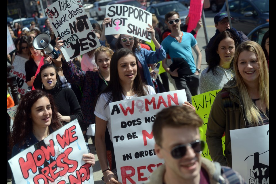 Roughly 100 people attended Sunday's slutwalk event in Downtown Guelph, listening to speakers in St. George's Square then marching around the downtown with signs. Tony Saxon/GuelphToday