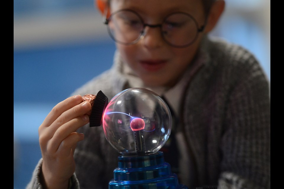 Focusing on some science at the astronomy room where U of G professors teach children the science behind the magic at the annual School of Wizardry and Witchcraft event.  Tony Saxon.GuelphToday file photo