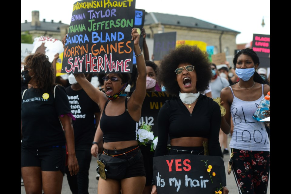 A woman yells at Saturday's Guelph Solidarity Protest to Support Black Lives Matter as the event marches down Wyndham Street. Tony Saxon/GuelphToday