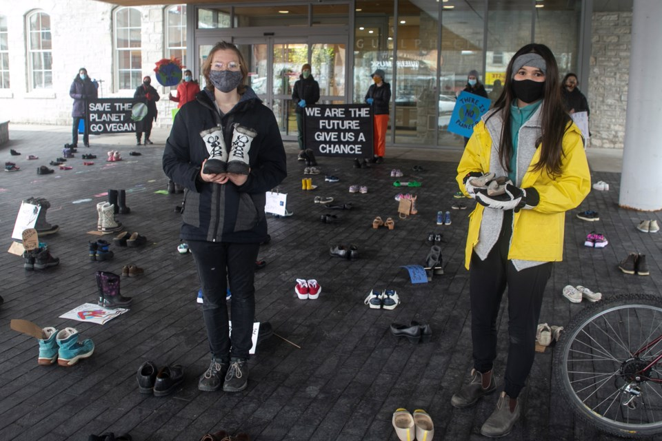 Eli Shifflett, left, from GCVI and Kellie Elrick from John F. Ross, both Grade 12 students, are among the organizers of Friday's shoe strike. The initiative is in solidarity with Guelph Fridays for Future, Kitchener-Waterloo Climate Save, Youth Action on Climate Change, and Extinction Rebellion. Kenneth Armstrong/GuelphToday