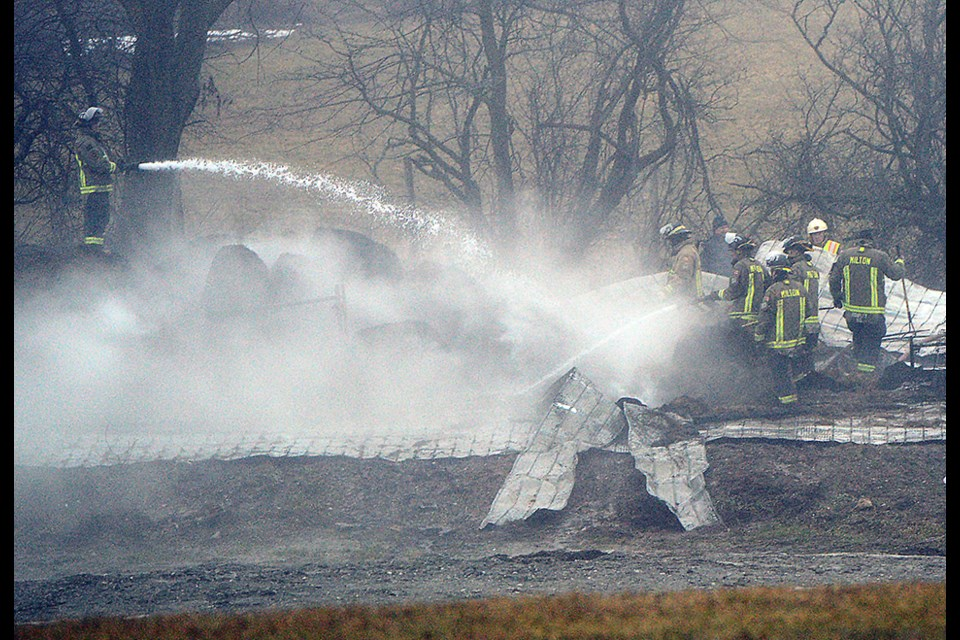 Members of the Milton Fire Department work on hot spots at a fire just east of Rockwood Monday, Jan. 23, 2017, morning. Tony Saxon/GuelphToday