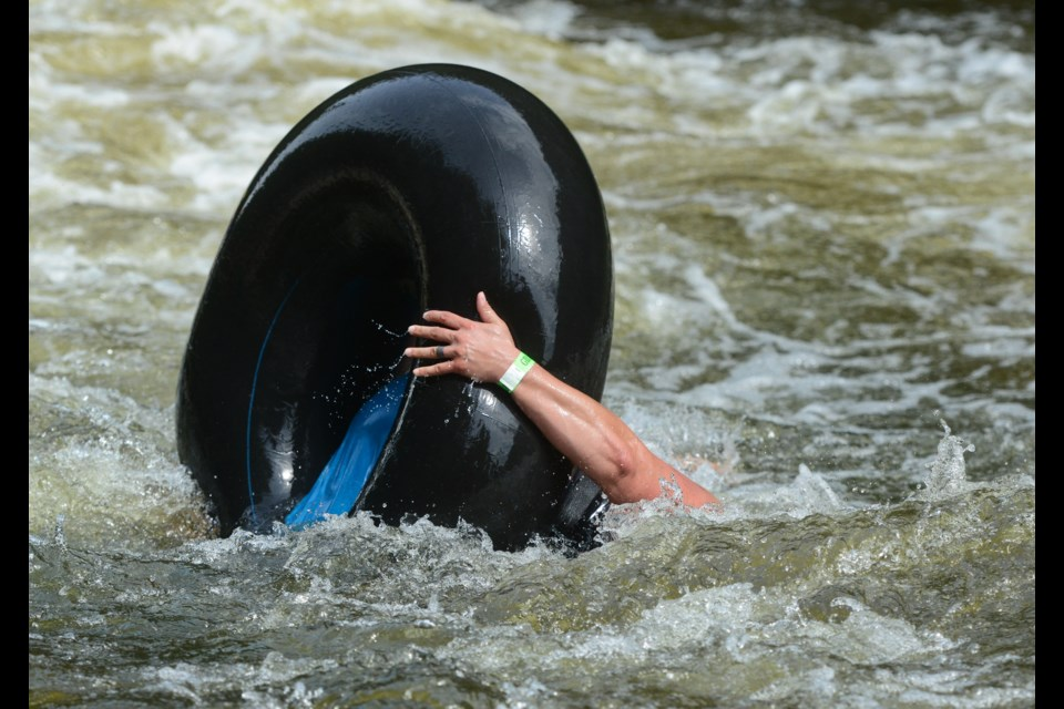 A tuber gets momentarily upended as she starts her trip down the Grand River on a sold-out tubing day at the Elora Gorge Conservation Area on Saturday. Tony Saxon/GuelphToday