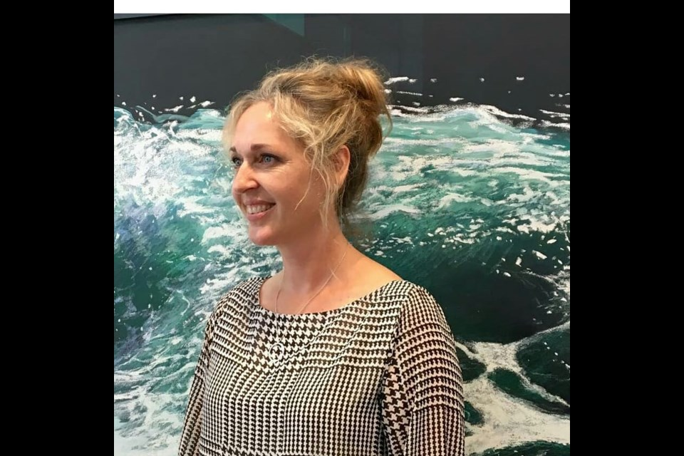 Jessica Masters in front of her Wave Series at R.I.C.A Gallery, Sept 2018