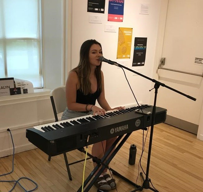 Singer-songwriter and GEAMP participant Mikalyn Hay performing at the opening reception of Treading Loudly. Photo credit - Shawn Chen, RBC