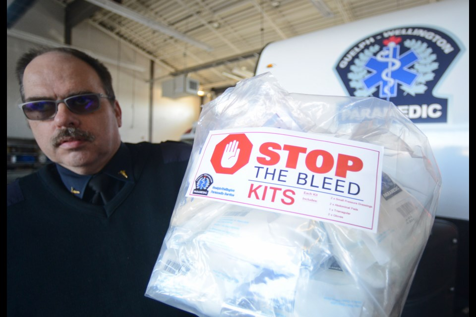 Stephen Dewar, general manager of Guelph Wellington Paramedic Services, holds a bag containing five Stop The Bleed kits. Tony Saxon/GuelphToday