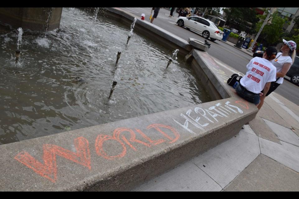 Writing on the fountain wall. (Rob O'Flanagan/GuelphToday)