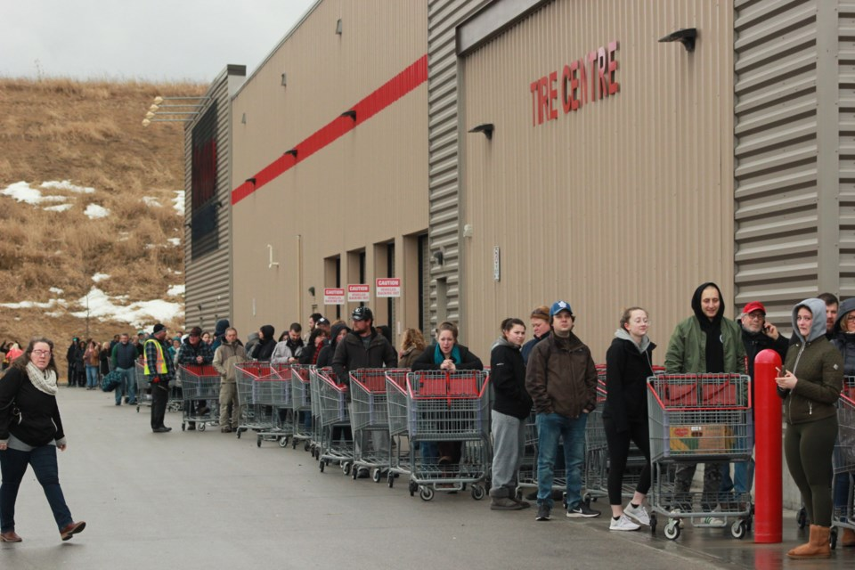 Customers line up outside the Guelph Costco before doors open at 9:30 a.m. Friday. Anam Khan/GuelphToday