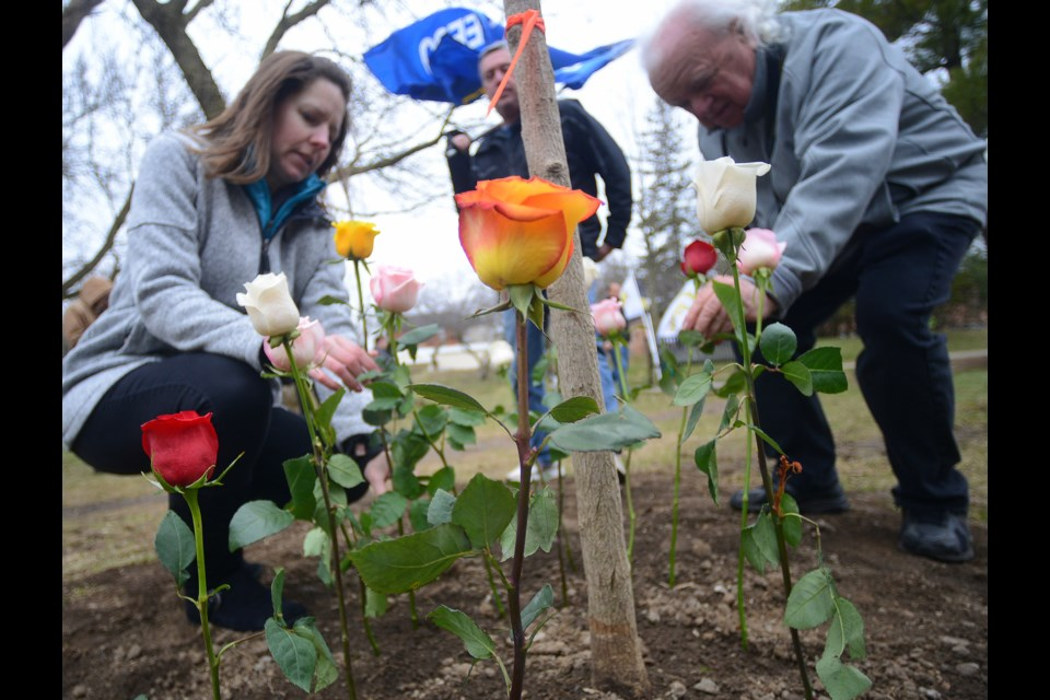 Flowers are left Saturday, April 28, 2018, at Goldie Mill Park in recognition of workers killed and injured in the workplace. Tony Saxon/GuelphToday