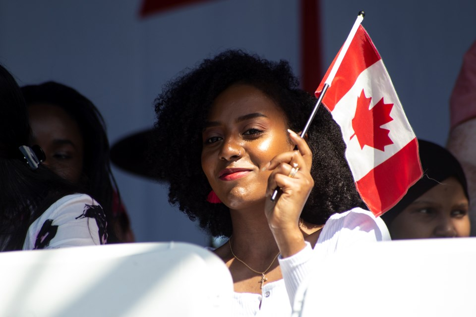 A Canadian flag is waved during a ceremony performed in 2019 at Riverside Park. Kenneth Armstrong/GuelphToday file photo
