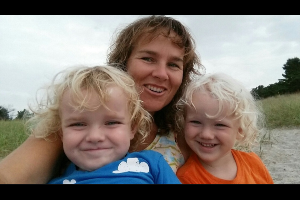 Cindy Graham, centre, with her twin sons Darwin Graham, left, and Dean Graham, right.