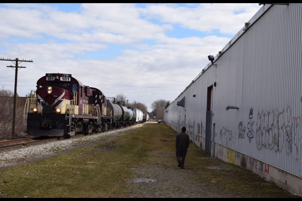 Train along the factory wall. Rob O'Flanagan/GuelphToday