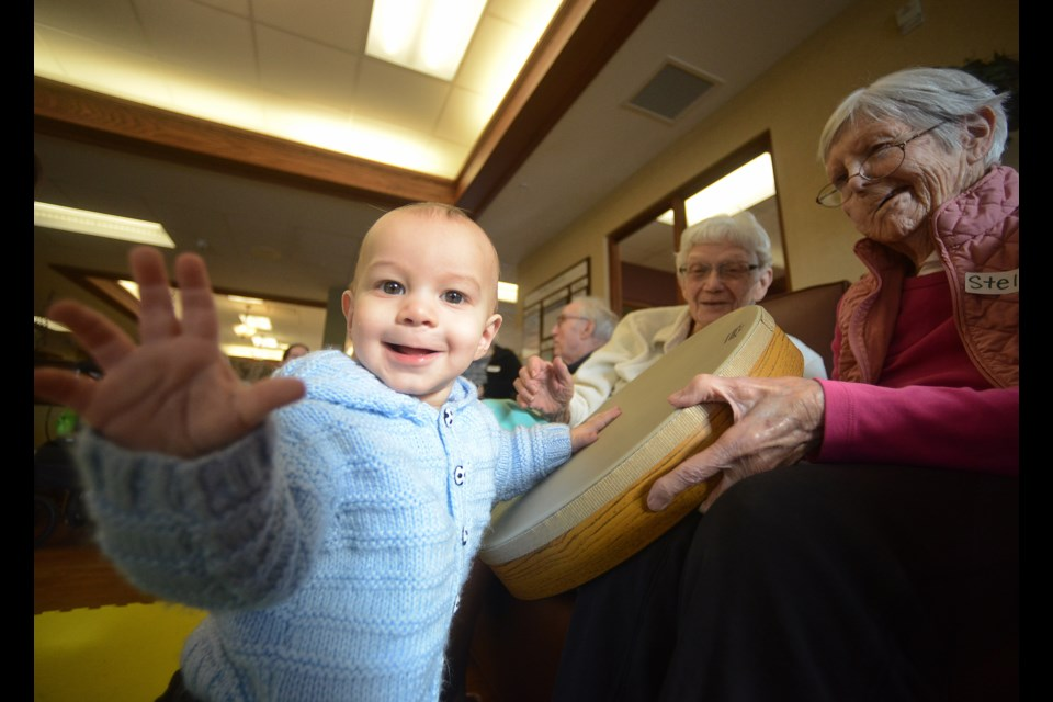 Liam shares a smile while engaging with residents at The Village of Riverside Glen during a music therapy session Thursday, Feb. 1, 2018. Tony Saxon/GuelphToday
