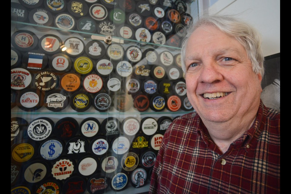 David Kendrick stands beside just a portion of his almost 2,700 hockey puck collection. Tony Saxon/GuelphToday