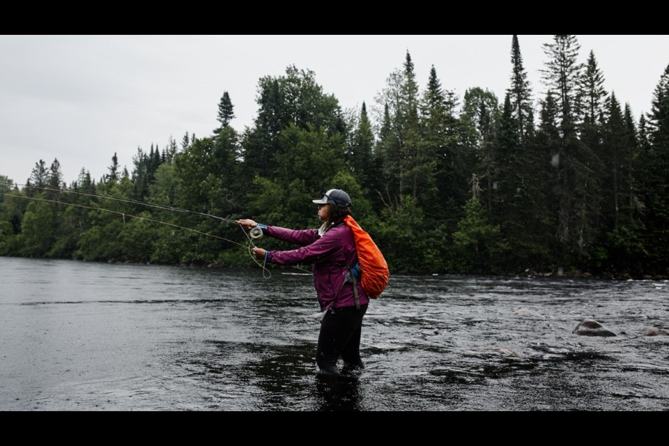 Dionne Daley casting her line while out fly fishing. Gabriel Bizeau Photographie photo