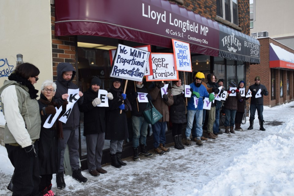 """Make every vote count."" An electoral reform rally gathered in front of Guelph MP Lloyd Longfield's Cork Street office Tuesday. Rob O'Flanagan/GuelphToday"