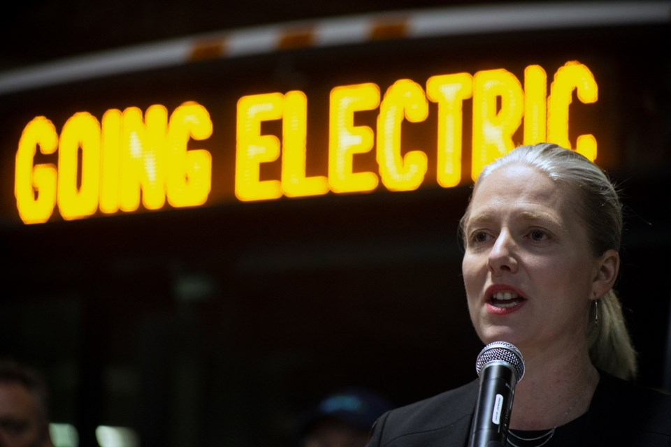 Catherine McKenna, Canada's minister of Infrastructure and Communities, speaks at a funding announcement Thursday at the Guelph Transit Garage.Guelph Transit will electrify much of its fleet of buses in the near future, with support from all three levels of government. Kenneth Armstrong/GuelphToday