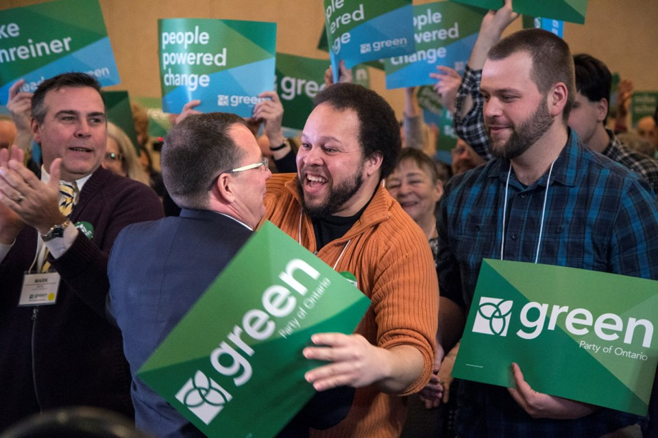 Mike Schreiner, leader of the Green Party of Ontario, seen greeting delegates immediately prior to making the keynote address Saturday at the party's convention in Guelph.
