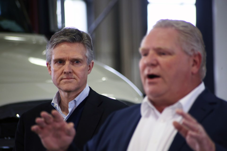 Rod Phillips, minister of the Environment, Conservation and Parks, looks on as Premier Doug Ford speaks at an event in Cambridge on Wednesday. Kenneth Armstrong/GuelphToday