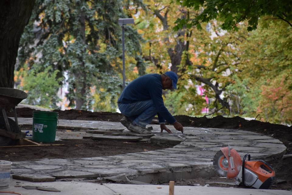 A mason lays limestone on the walkway of the Garden of Grace on Catholic Hill. Rob O'Flanagan/GuelphToday