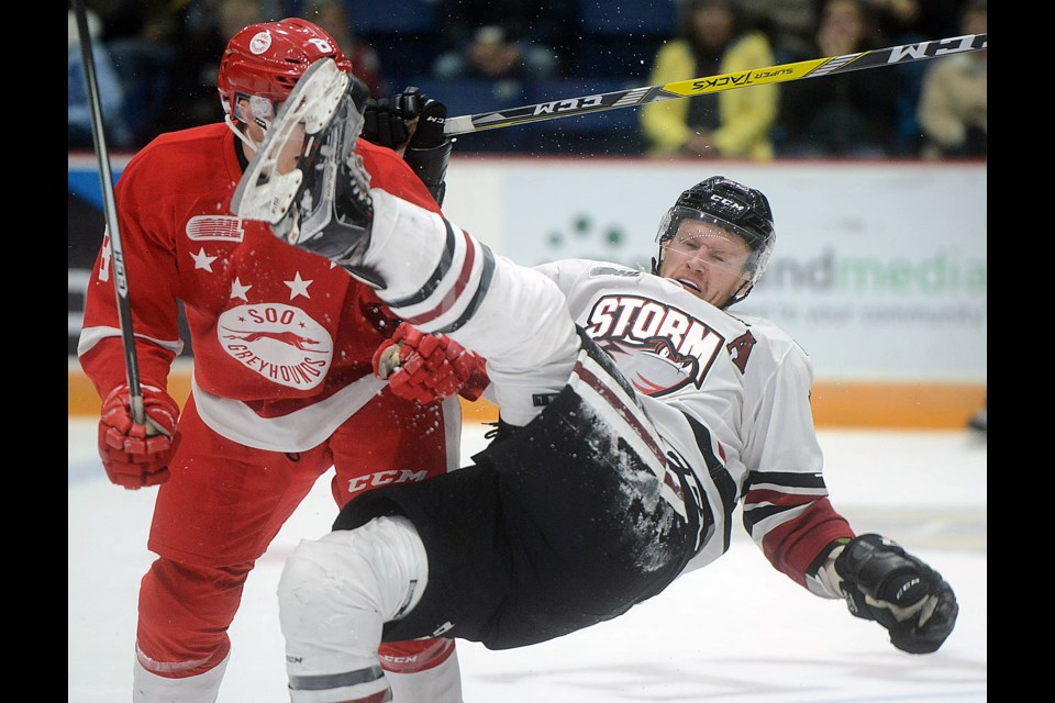 Matt Hotchkiss of the Guelph Storm goes flying after running into the Sault Ste. Marie Greyhounds' Jacob LeGuerrier Sunday, Oct. 31, 2016, at the Sleeman Centre. Tony Saxon/GuelphToday