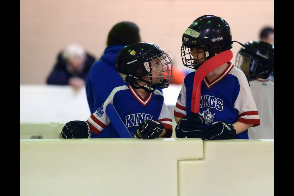 A couple of players wait their turn to get in the game. Tony Saxon/GuelphToday