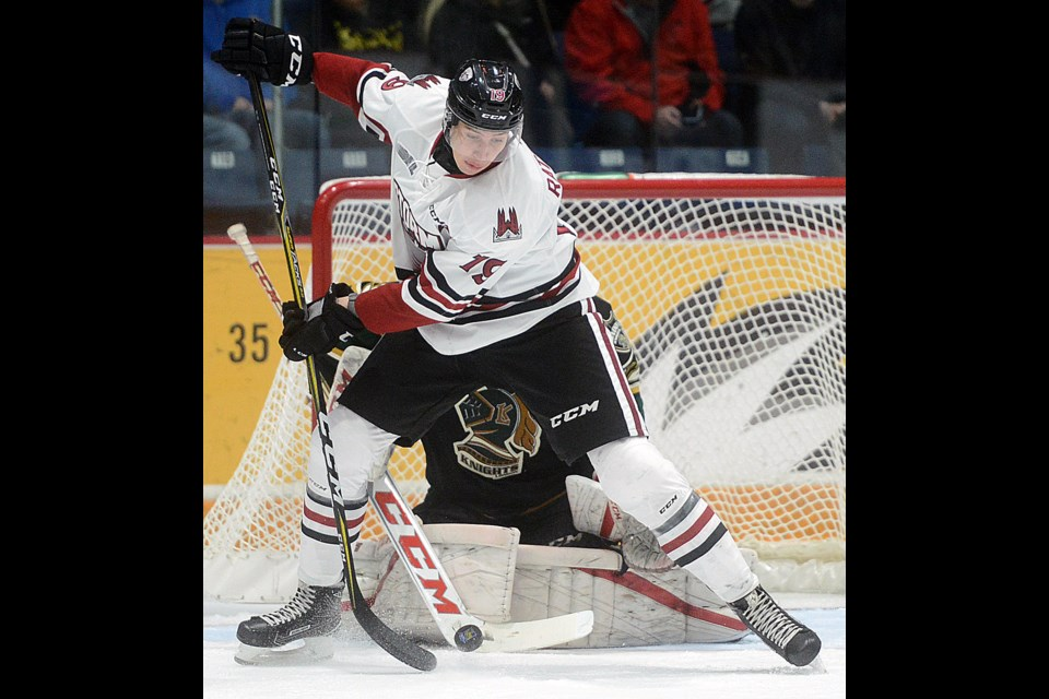 Isaac Ratcliffe of the Guelph Storm tries to tip a point shot in front of London Knights goaltender Joseph Raaymakers Sunday, Oct. 29, 2017, at the Sleeman Centre. Tony Saxon/GuelphToday