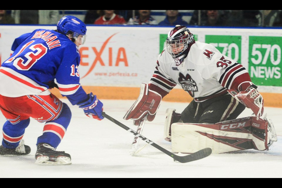 Riley Damiani of the Kitchener Rangers moves in on Nico Daws to score the overtime winner Friday at the Aud. Tony Saxon/GuelphToday