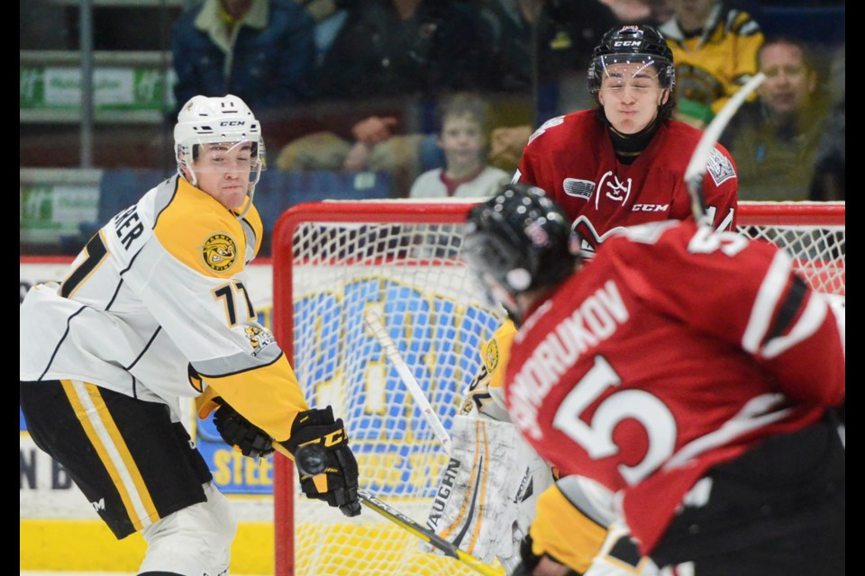 The Guelph Storm's Cedric Ralph and a Sarnia Sting defender react to a slap shot by the Storm's Dmitri Samorukov Friday at the Sleeman Centre. Tony Saxon/GuelphToday
