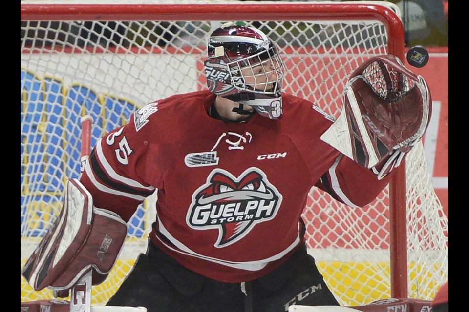 Guelph Storm goaltender Nico Daws keeps his eye on a puck that hit the post Sunday at the Sleeman Centre. Tony Saxon/GuelphToday