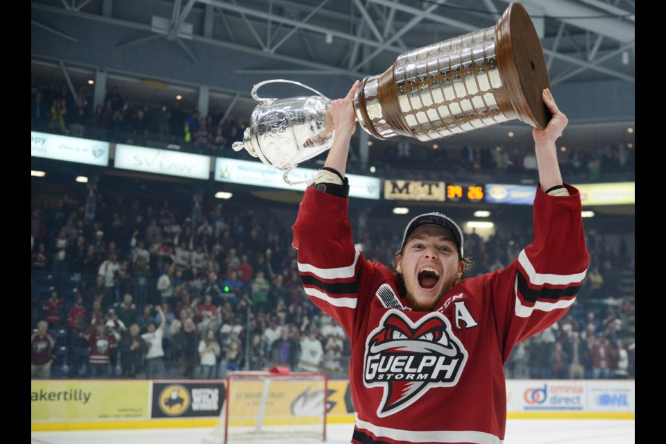 Nate Schnarr yells as he hoists the championship trophy Sunday at the Sleeman Centre. Tony Saxon/GuelphToday