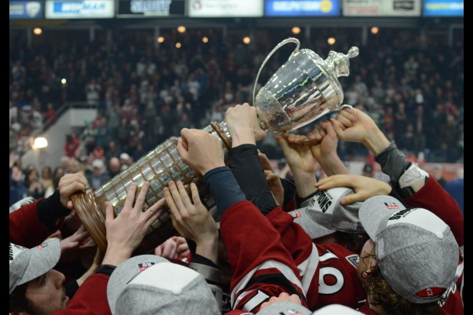 Players hoist the trophy. Tony Saxon/GuelphToday