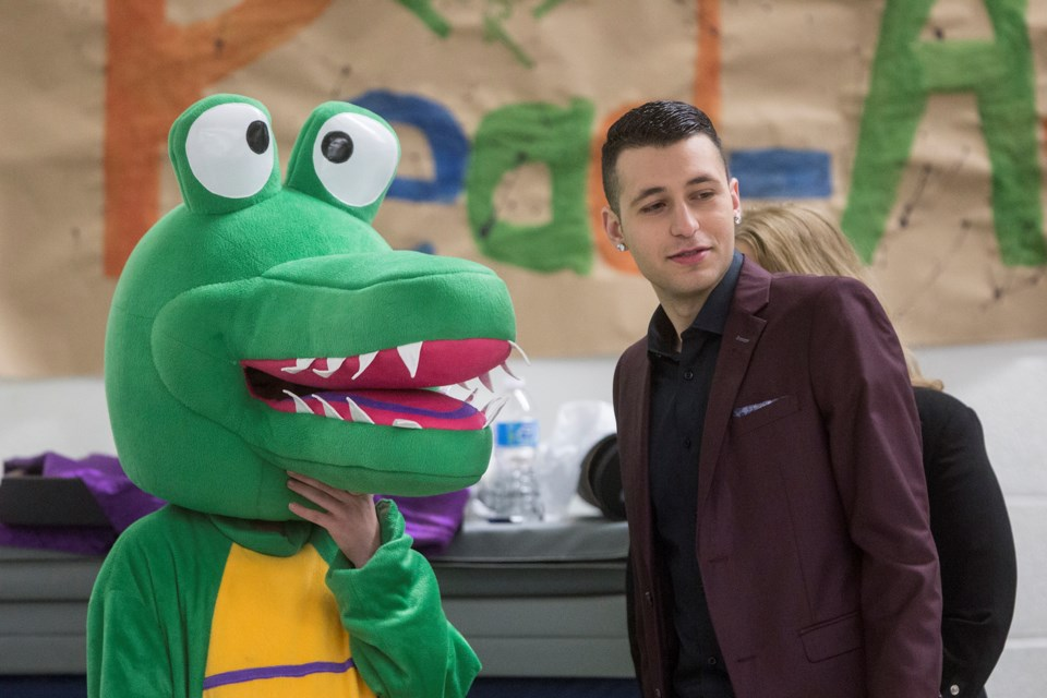 Martial artist Nathan Skoufis speaks with Ace, mascot of Aberfoyle Public School, immediately before a speaking engagement to kick off the school's Read-to-Succeed Read-a-thon. Kenneth Armstrong/GuelphToday