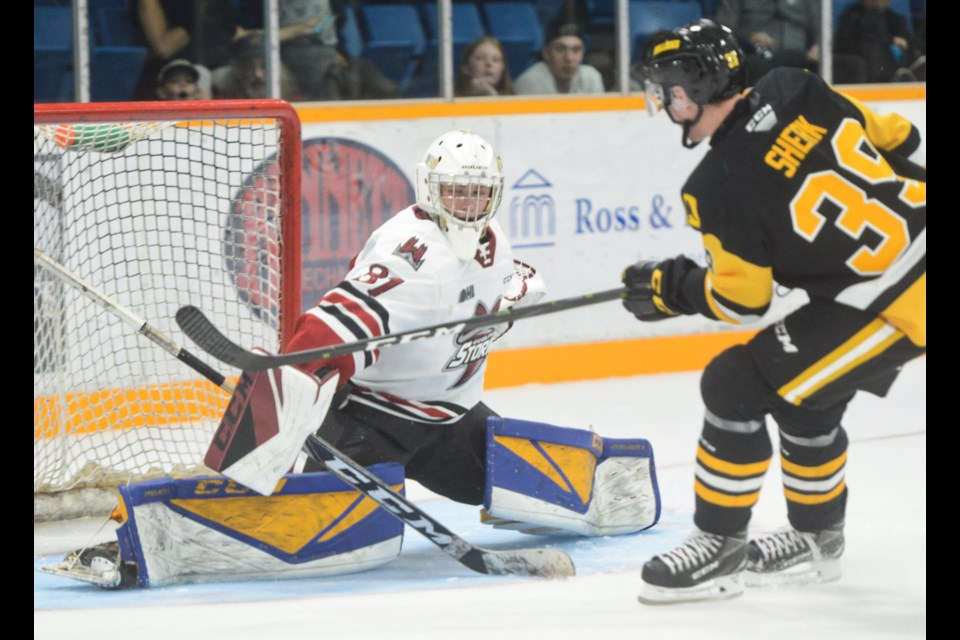 Guelph Storm goaltender Owen Bennett makes a breakaway save on Hamilton's Lawson Sherk Saturday in Hamilton. Tony Saxon/GuelphToday