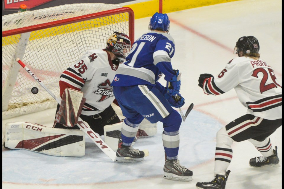 Nolan Hutcheson of the Sudbury Wolves scores what proves to be the winning goal on Guelph Storm netminder Nico Daws Sunday at the Sleeman Centre. Tony Saxon/GuelphToday
