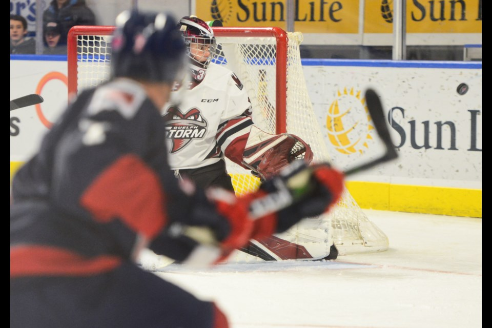 Guelph Storm goaltender Nico Daws watches as a Kitchener Rangers player shoots wide Friday in Kitchener. Tony Saxon/GuelphToday